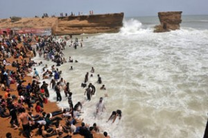 Pakistanis enjoy the beach during hot weather in Karachi on July 4, 2010. AFP PHOTO/Rizwan TABASSUM (Photo credit should read RIZWAN TABASSUM/AFP/Getty Images)
