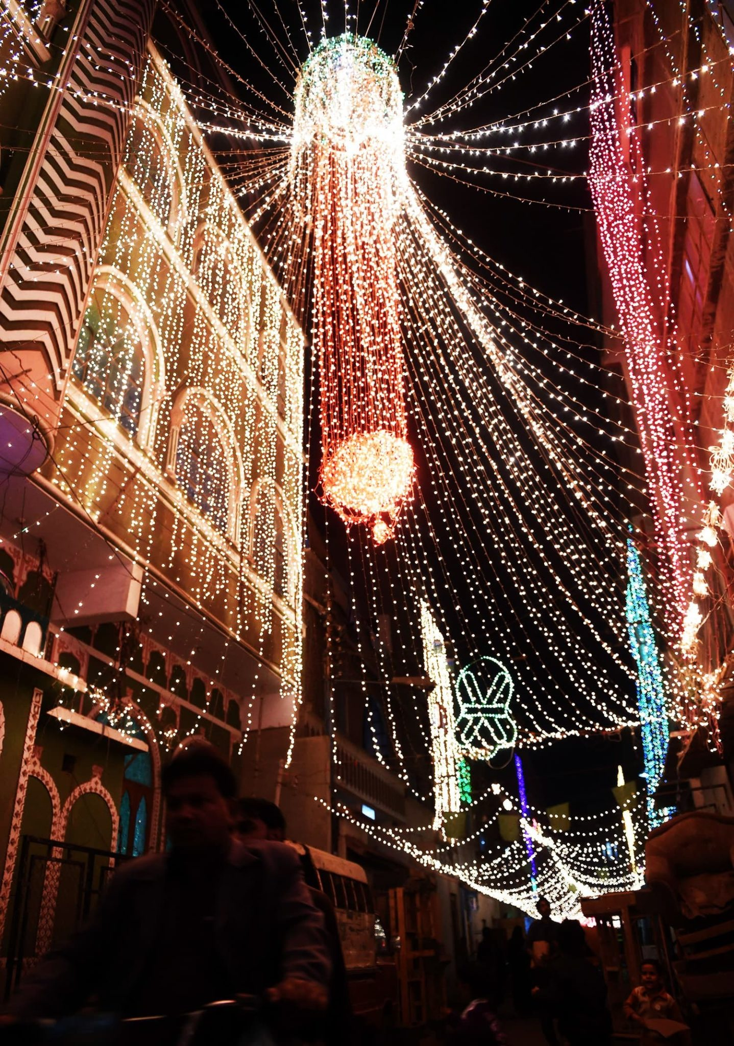 Pakistani men ride past a mosque decorated to celebrate the birthday of Prophet Mohammed in Karachi on December 23, 2015. The birthday of Prophet Mohammed, also known as 'Milad', is celebrated during the Islamic month of Rabi al-Awwal, which falls on December 24, 2015 in Pakistan. AFP PHOTO / Rizwan TABASSUM