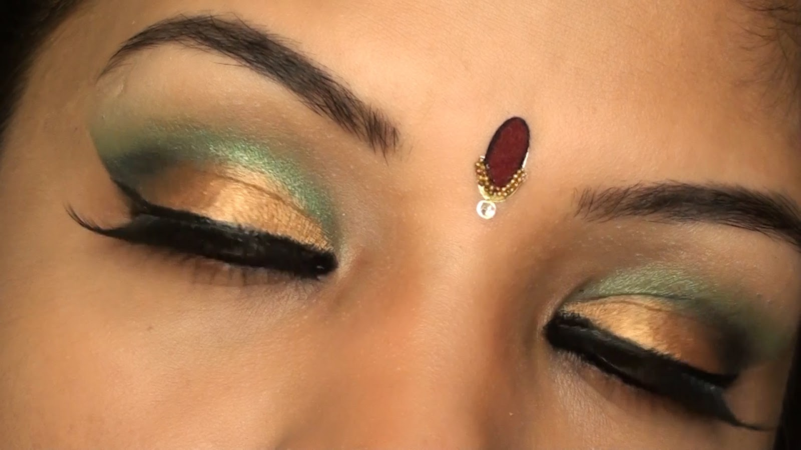 Bollywood Inspired Indian Bridal Wedding Make up Tutorial Gold and Green eye makeup for Brown skin tone .Still001