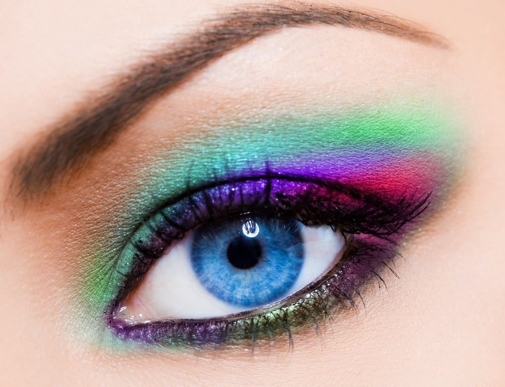 close-up-of-beautiful-woman-multicolour-eye